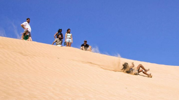 Sliding on the sand dune, Negev desert, Israel
