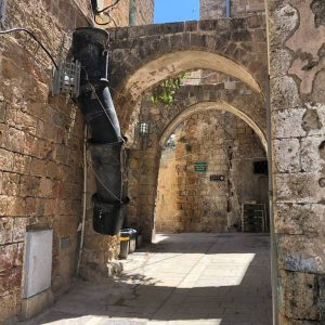 Tylical alley with stone arch in old Akko